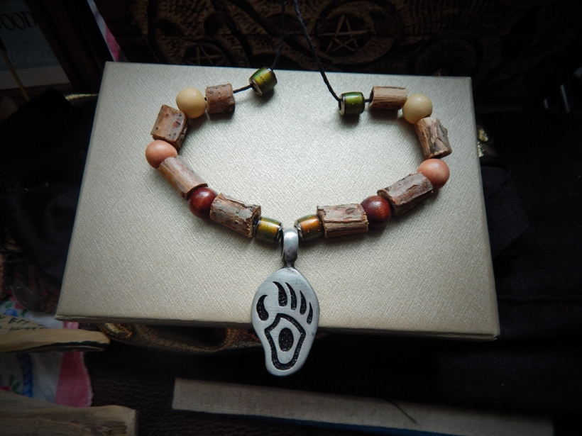 He gave me the metal pendant, but I added the beads, myself. I like wooden beads.